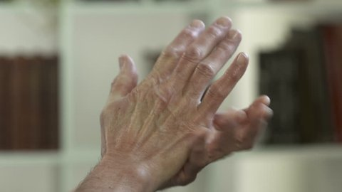 Man with arthritis pain in his hands
