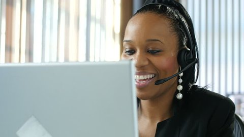 Portrait of a young female customer service representative