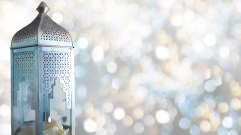 Arabic ornamental lantern with burning candle. Festive glittering bokeh lights background. Ramadan background. loopable Ramadan HD footage