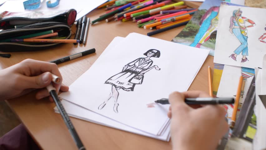KHERSON, UKRAINE - MARCH 09, 2016: Fashion designer is working on a new collection, making sketches in studio | Shutterstock HD Video #15407212