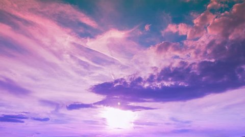 Time lapse footage of scattered clouds over gradient sky near the sunset time, passing above the sun centered at the bottom of the shot. Magical pink and purple color scheme.