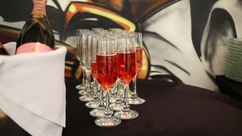 Glasses with Sparkling rose wine and bottles in ice bucket