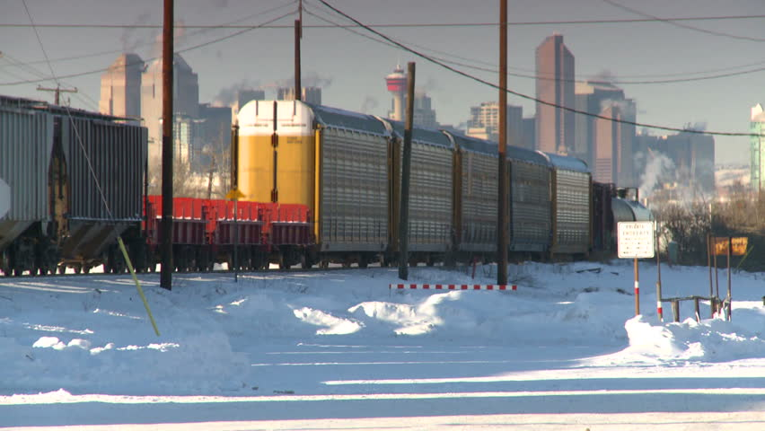 intermodal freight train, Calgary skyline in background