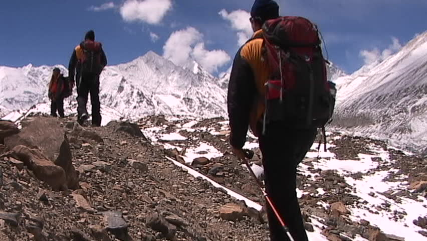 Climbers walk into panoramic Himalayan background