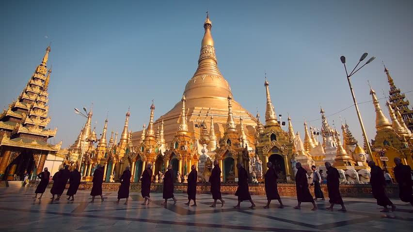Yangon, Myanmar - March 12: Buddhist monks walking in line around Shwedagon Pagoda in Yangon, Myanmar (Burma).