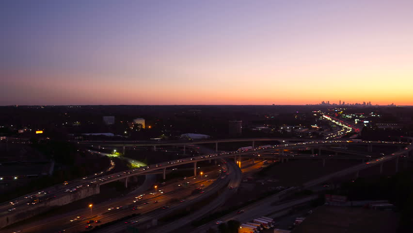 Atlanta Aerial v225 Flying low near Spaghetti Junction freeways panning with cityscape dusk views.