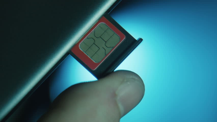 The person installs by a finger the slot with the SIM card in the cell phone   Shutterstock HD Video #15484432