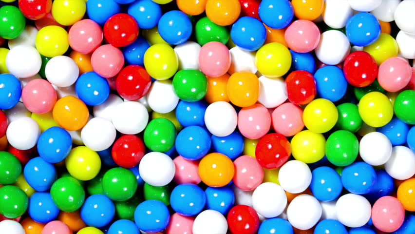 A rotating bowl of sweet candy gumballs in various bright colors