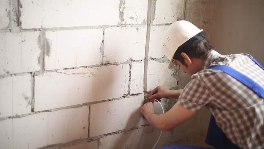Stock Video Of The Man Performs Electrical Installation Work