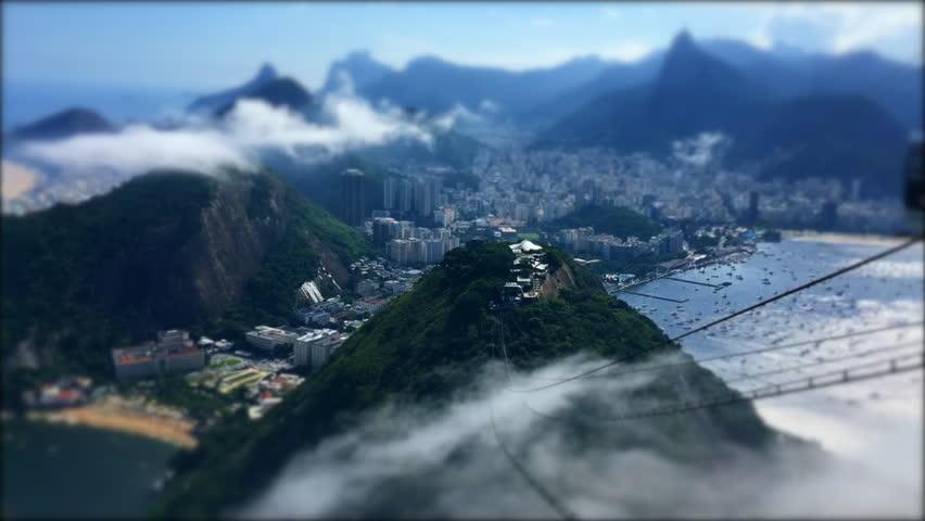 Mist swirls across the jungle karst mountains of the Rio de Janeiro Brazil skyline