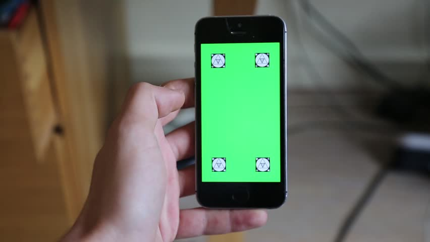 Smartphone Green Screen Vertical / Vertical Green Screen Smartphone / Hands holding a smartphone in vertical position with a green screen on it for incrustations | Shutterstock HD Video #15583549
