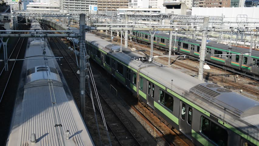 Passenger Trains moving in Ueno Station with rail cars and train tracks, HD video