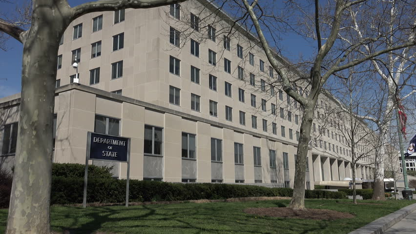 WASHINGTON, DC - MARCH 2016: US State Department headquarters building, flag flying.  Headquarters of United States Department of State, C St. NW, DC.  Officially the Harry S Truman Building.