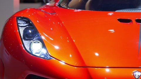 4K italian luxury red car / Dream sport vehicle in a motor show