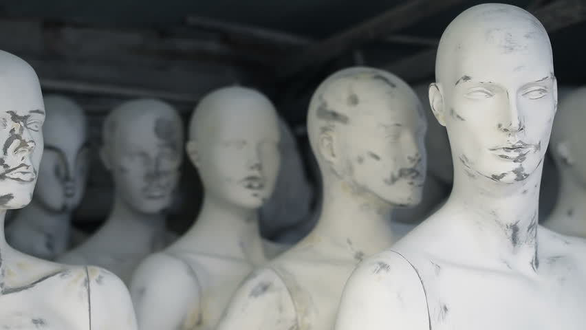 Unfinished male and female white mannequins are standing, pan