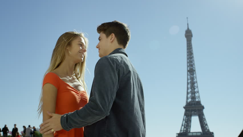 Couple enjoying each others company while visiting the Eiffel tower in Paris. Paris, France | Shutterstock HD Video #15687070
