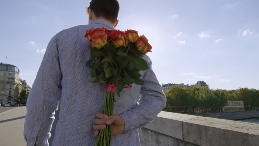 Young man gives his lady a bunch of roses and a big kiss while in Paris- Paris, France | Shutterstock HD Video #15692746