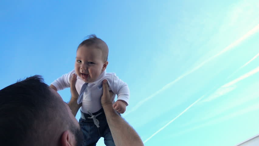 Young father playing with his small, funny son against the sky, super slow motion  #15701458