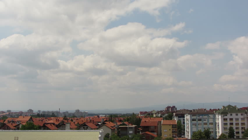 Long time lapse shot of clouds moving over the rooftops in city of Nis, Serbia.