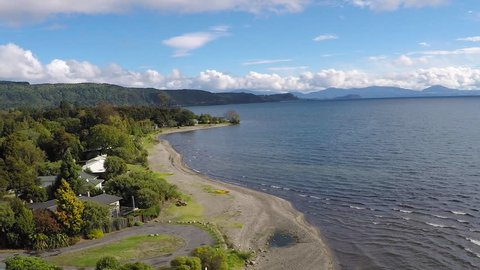 NEW ZEALAND - LAKE TAUPO - APRIL 2016 - New Zealand's largest freshwater lake, Lake Taupo is a popular destination for holidaymakers and fishing. This aerial shot is above the small village of Hatepe.