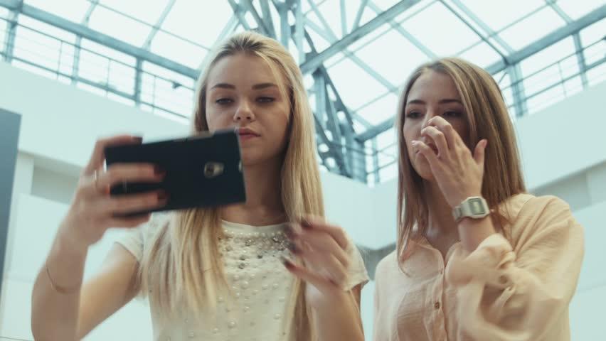 ZAPOROZHYE, UKRAINE - JANUARY 15, 2016: Avrora city mall. Girlfriends do the selfie in entertainment shopping center | Shutterstock HD Video #15731257