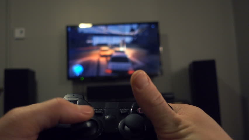 MONTREAL, CANADA - March 01, 2016. First Person View of a Man Playing to GTA (Grand Theft Auto) , a Violent Playstation Action Video Games.
