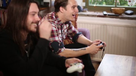 Two Friends Enjoy Multiplayer Video Game