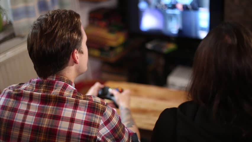 Two Men Play Online Video Games Together