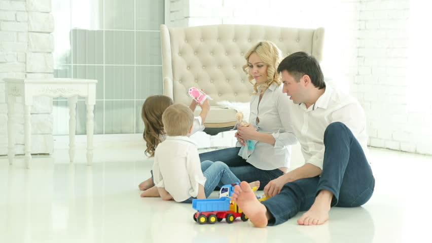 Family Play Together. Dad Mom And Son And Daughter Playing Together. Happy  European Family