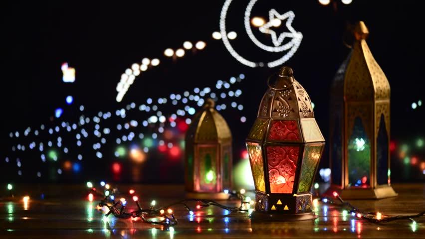 Many illuminated Arabian traditional Ramadan lamps and blinking xmas lights. Islamic festive background.