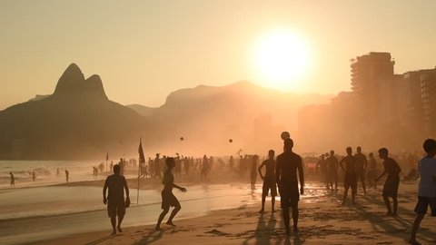 Silhouettes of Brazilians Playing Beach Football in Ipanema by Sunset.