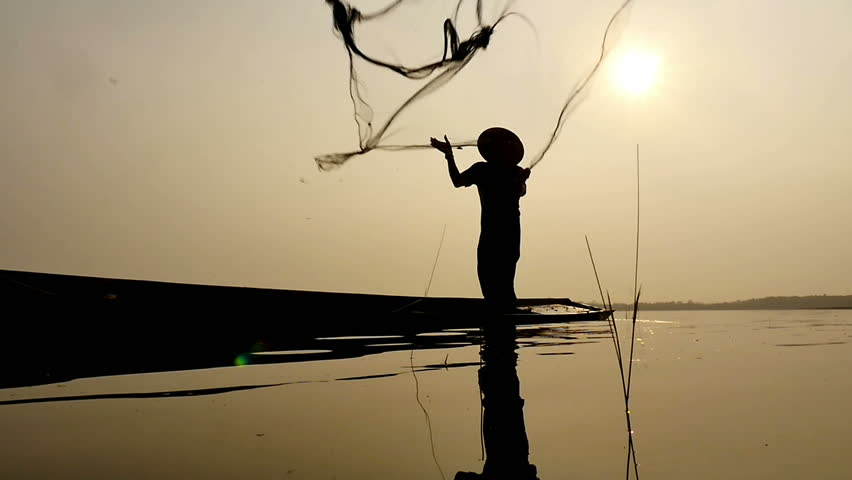 Silhouette of traditional fishermen throwing net fishing in the lake at sunrise time | Shutterstock HD Video #15800161