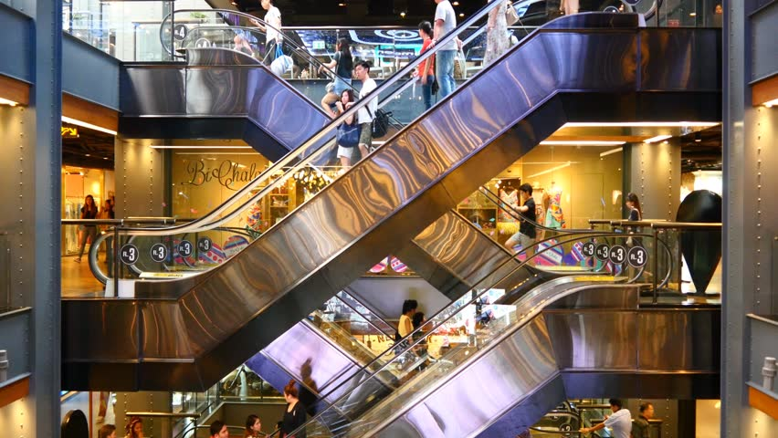 Escalator 4k shopping mall crowd of people buy shop center centre last minute sale sales purchases rush hour very busy full of clients big shopping mall complex time lapse timelapse fast video