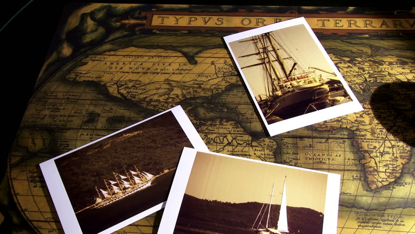 Golden compass, old maps and sailing ships photos, pan right