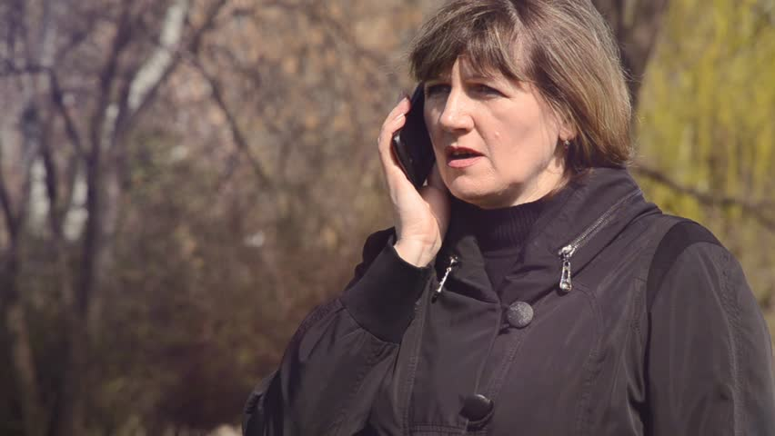 Woman talking on the phone outdoors   Shutterstock HD Video #15813832