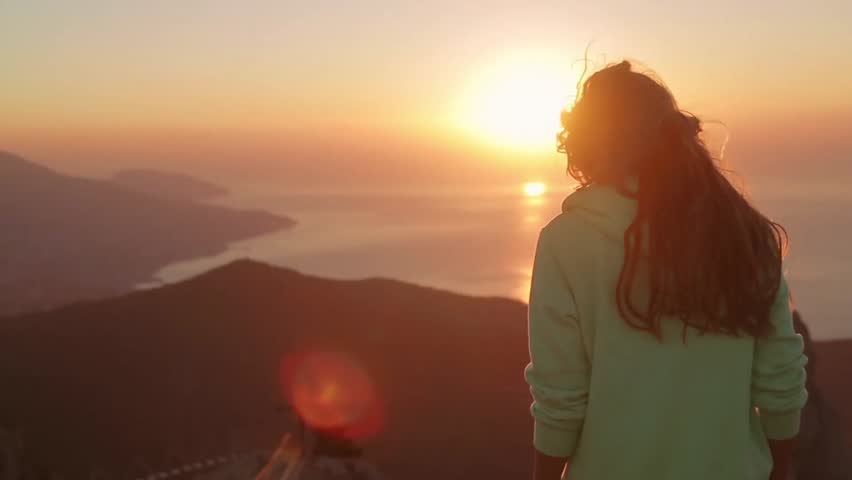 Young Attractive Woman Watching Sunset or Sunrise Over Bay from Top of the Mountain, Girl Takes Panorama Photos On Phone.Hair in the Wind. Handheld Atmospheric Shot. Crimea, Ukraine.  #15818542