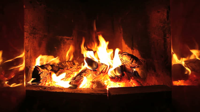 the dying embers in the fireplace