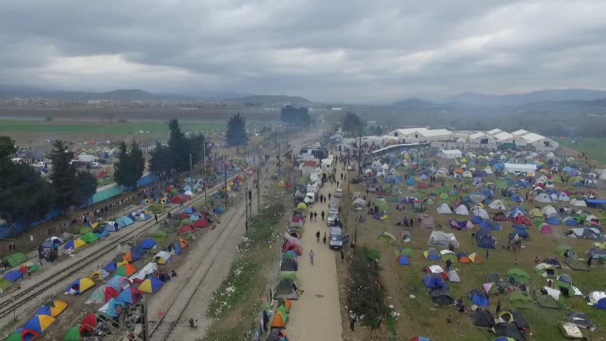 Tents in a transit camp for migrants and refugees are seen from a drone on a foggy morning on the Greek side of the Greek-Macedonian border near Idomeni, Greece, on March 6, 2016. #15830488