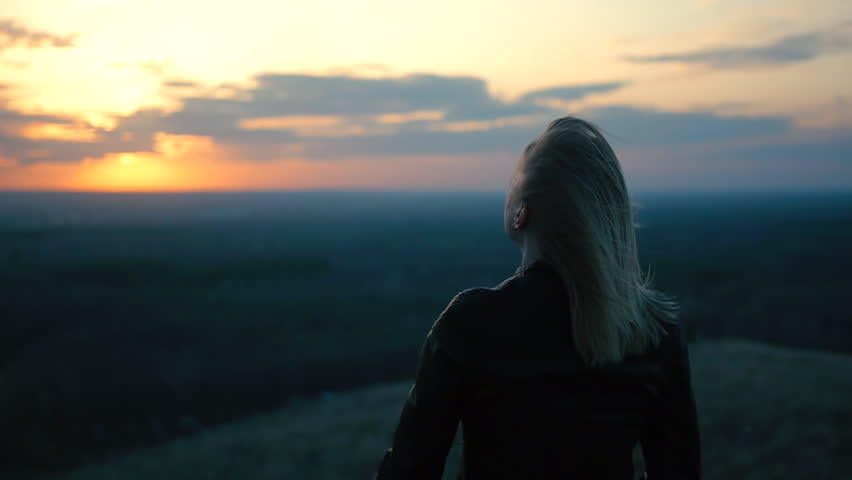 beautiful girl watching the sunset smiling life dreaming of jumping the wind pulls the girl's hair silhouette backlight from the sun beautiful scenery red sunset sunset portrait of a beautiful woman #15854482