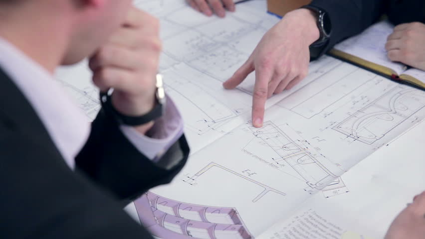 Group engineers and architects discuss the blueprint. | Shutterstock HD Video #15892492