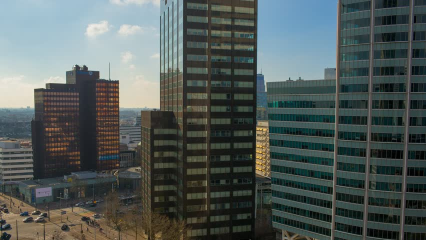 Static day to night timelapse/time-lapse with the sunset on a spring afternoon with the sun setting between the skyscrapers and urban city skyline of Rotterdam, the Netherlands April 2016 | Shutterstock HD Video #15909172