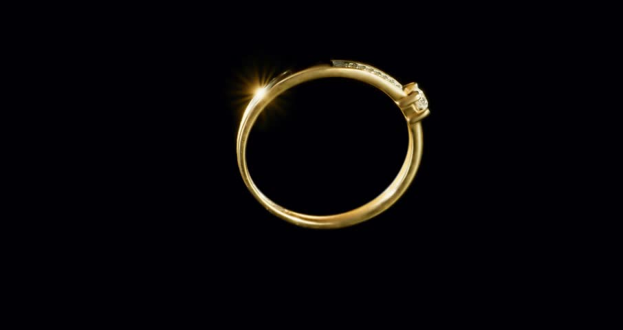 Rotating Yellow Gold Ring With One Diamond In The Middle And Row Of Diamonds Along