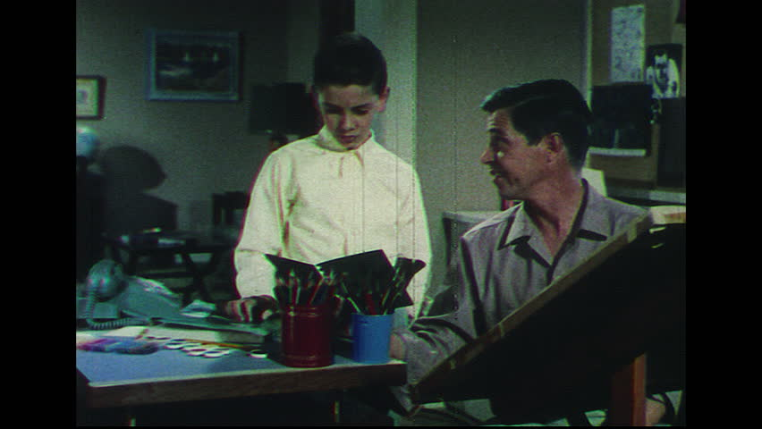 UNITED STATES 1960s Boy And Uncle Look Out Of House Window