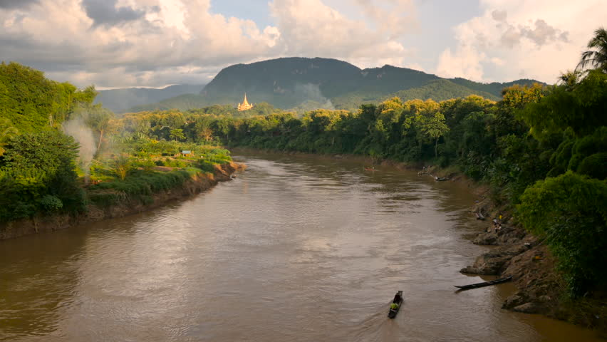 LUANG PRABANG, LAOS - 27 SEPT 2014: View over the Mighty Mekong River and Luang Prabang mountains in the afternoon