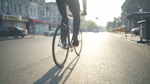 close up male wearing classic shoes pedalling slow motion