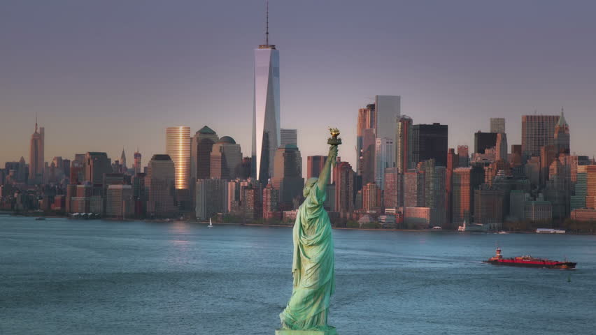 Statue of Liberty in New York City with Lower Manhattan and Jersey City in Background. | Shutterstock HD Video #16032052