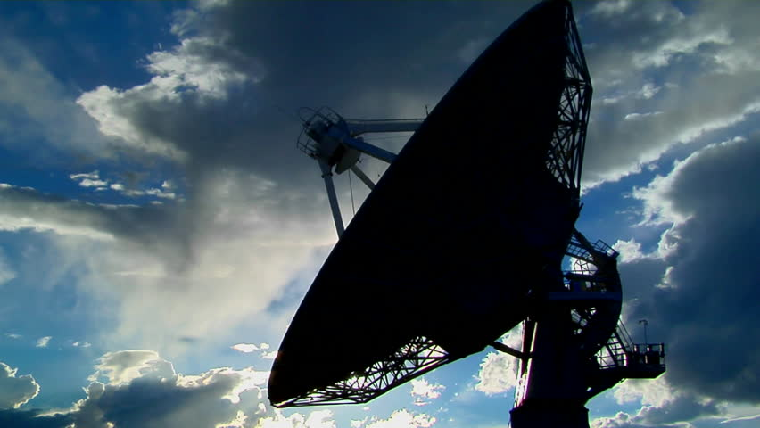 A satellite dish moves in time-lapse and is silhouetted against the sky | Shutterstock HD Video #1603552