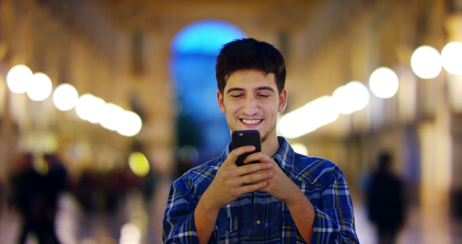Man look at night in city. Milan italy  Handsome young business man using telephone smiling happy wearing wearing blue shirt. Urban male. | Shutterstock HD Video #16056202
