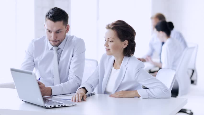 Group of business people having a meeting | Shutterstock HD Video #16057582