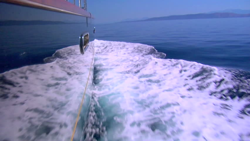 The wake of a boat as seen from the side of a ship.